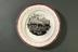 Commemorative plate, 1835, railway scene.Photographed on a grey background.