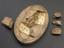 """Plaster mould, Venus, oval 10"""" x 7"""". Top three quarter view with sections removed and displayed alongside mould. Dark"""