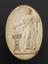"""Plaster cast, Priestess pouring Libations on altar with right hand. Holding a branch with left hand, oval 4 1/2"""" x 3""""."""