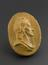 """1 Reproduction in wood, marked on back """"Spring 1809"""" oval 2 1/4"""" x 1 5/8"""".  Front view of whole object against grey"""