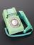 Trimphone, green.  Front 3/4 view of whole object against graduated grey background.
