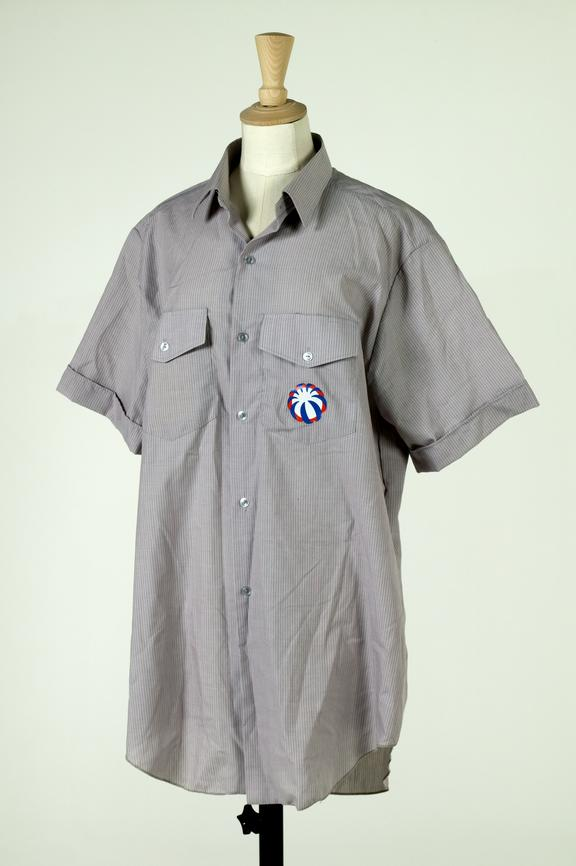 Manchester Airport ground staff shirt, c.1994.Photographed on a white background.