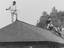 A man in pyjamas with a garden fork on the roof of a Maudsley Hospital outbuilding, police defend themselves with