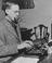 Sir Stafford Cripps at his portable typewriter answering his correspondence.       This is a fully retouched and clean,