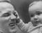 Henry Cooper Heavyweight Boxer with his son Henry Marco grabbing his left eye.       This is a fully retouched and clean,