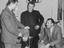 Left to right, David Herd, Tommy Docherty and Jack Kelsey in a sports equipment shop       This is a fully retouched and