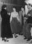 Elizabeth Taylor along with Robert Taylor and Janet Grey, Proops sketches a film outfit, 1940s.       This is a fully