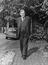 Lord Hailsham taking a walk in the sunshine near his home, Heathview Gardens, Putney, 1963.       This is a fully retouched