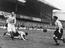 Stanley Matthews (left) beating Peter Sillett at The Dell, Southampton, 1953.       This is a fully retouched and clean,