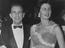 """Norman Wisdom and his wife, Freda Simpson, at the film premiere of """"The Prince and The Showgirl"""" at the Warner Theatre,"""