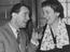"""Norman Wisdom gives a toast to Marion Grimaldi, both are in """"Where's Charley"""" at the Opera House, Manchester,"""