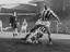 Stanley Matthews returns to Stoke, shown here being tackled by Wilson, 1961.       This is a fully retouched and clean,