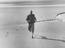 Stanley Matthews jogging on the beach in Blackpool at Squires Gate, prior to his return to Stoke City, 1961.       This is a
