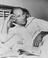 Stirling Moss in hospital after a car crash, 1959.       This is a fully retouched and clean, publication quality copy of an