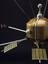 UK1 satellite (1:50 scale model?) with stand. Detail view showing main body of satellite. Black background (Ariel 1,