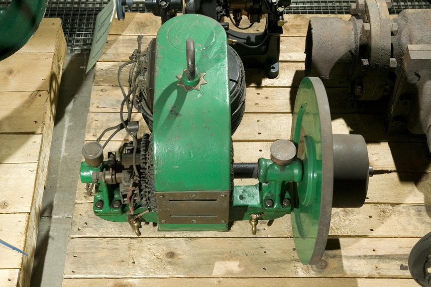 Small, green, electric motor.Made by the Faraday Electrical Engineering Co. Ltd, Glasgow.Photographed in Collections