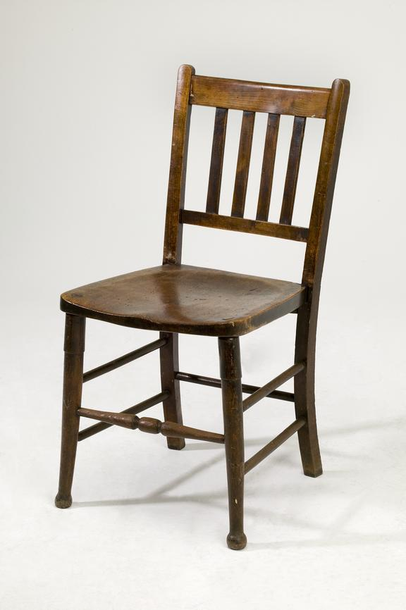 Wooden chair for switch room, c.1920.Photographed on a white background.