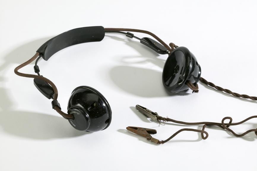 Telephone lineman's headphone set, c. 1940.Photographed on a white background.
