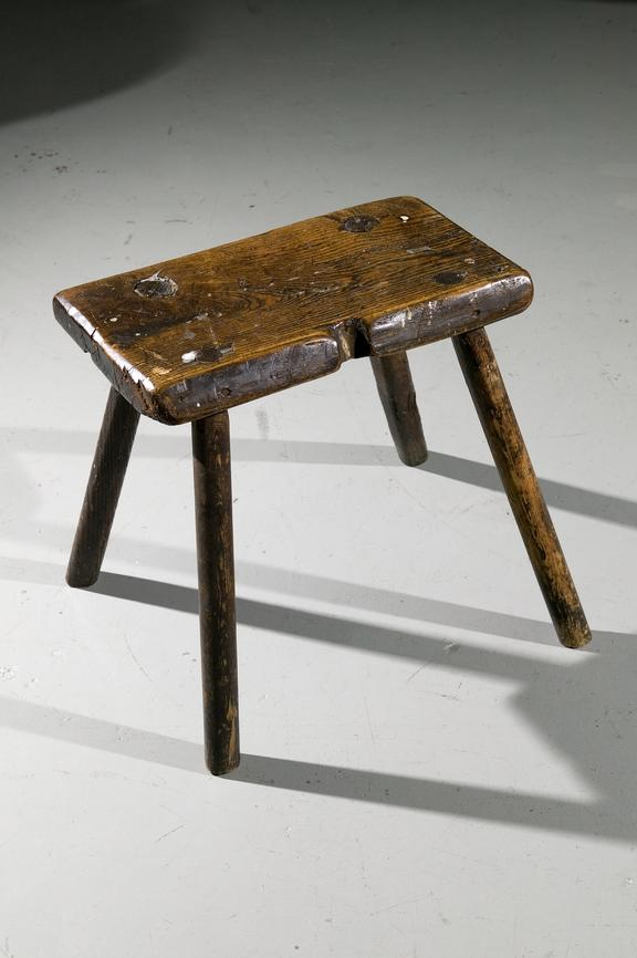 Wooden stool.Photographed on display in the Textiles gallery.