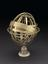 Made by Caspar Vopel in Cologne, Germany in 1522, this brass armillary sphere has a turned wooden stand.  A broad band,