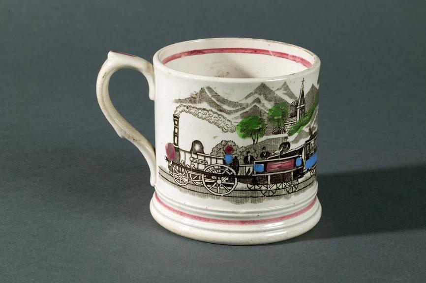 Railway-inspired decorative mug, c. 1830.Photographed on a grey background.The locomotive on this mug bears the