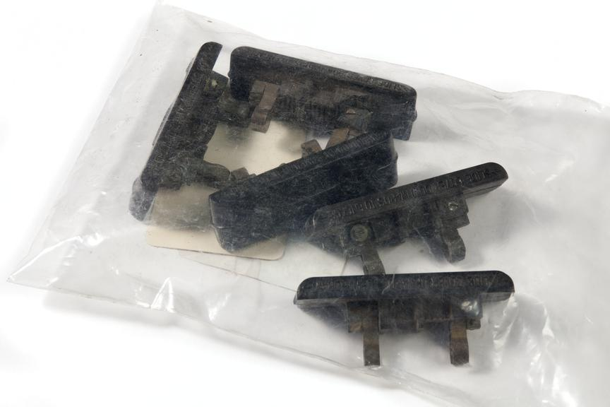 Plastic bag containing fuses.Photographed on a white background.