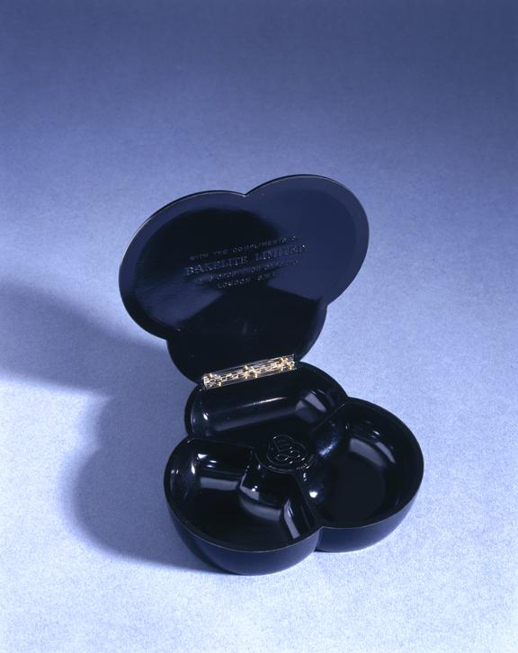 Bakelite pin tray with hinged lid in the company's trefoil shape, c. 1950. From a colour transparency in the Science