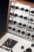 Analogue music synthesizer, 1970. Front three quarter detail view. Grey background. From a colour transparency in the