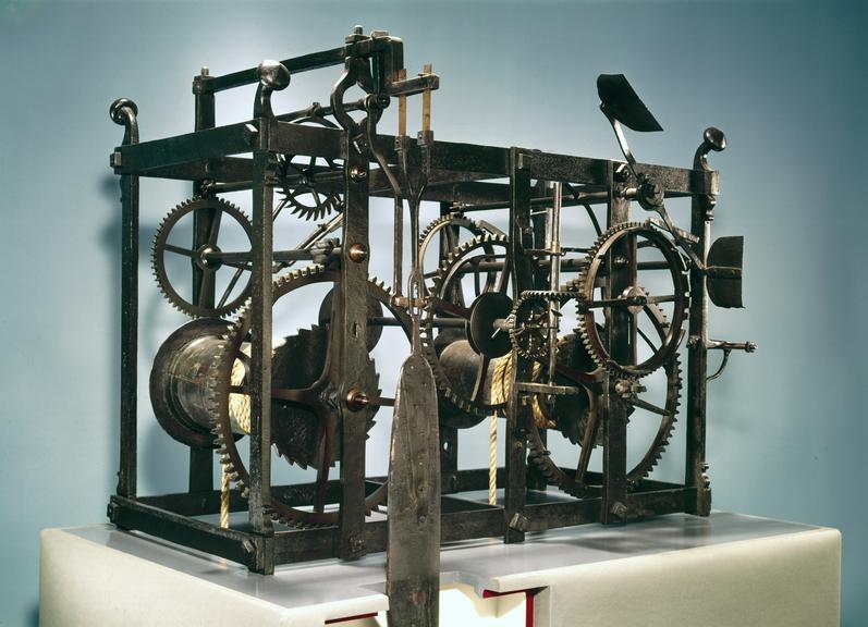Works of clock (dated 1671) removed from St Giles Church, Cambridge (received in pieces), including parts and weights.