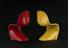 Two models, one red and one yellow of the full-sized Verner Panton chair, originally produced in 1959-60. These