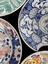 Group of ceramic barber's shaving bowls. Clockwise from top: Barber's shaving bowl, earthenware with melodramatic
