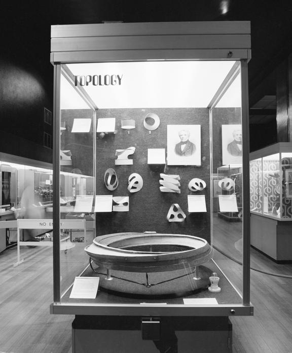 Mobius strip model with racing cars powered by a linear motor, by Eric Laithwaite, Imperial College, London, 1974 on
