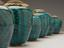 Group of Earthenware drug jars, with parchment lids, with turquoise glaze, Persian. Comprising of Earthenware drug jar,