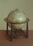 Terrestrial globe (diameter 13 3/4 inches) made by William Jansoon Blaeu on a wooden stand, early 17th century. From a