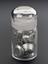 Glass-stoppered bottle containing tin.  Front view of whole object against graduated grey background.