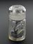Glass-stoppered bottle containing lead.  Front view of whole object against graduated grey background.