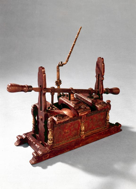 Model of early manual fire engine, ca. 1680. From a colour transparency in the Science Museum Photographic Archive.