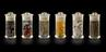 Group shot of six specimen jars. Consisting of (from left to right): Tall cylindrical clear glass jar with circular
