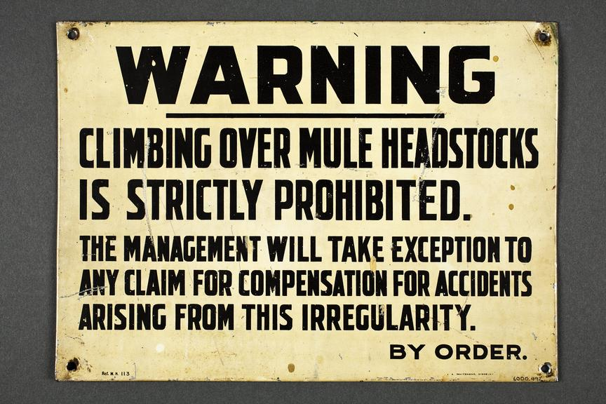 Notice forbidding workers to climb over the mule headstock