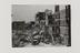 aily Herald contact print by F. Greaves, showing a general view of the damaged caused by a bomb in  Stepney, East