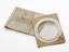 """1 Convexo convex lens 5 3/8"""" dia in cardboard 8 1/4"""" x 6 5/8"""" in paper marked """"concave flint glass"""""""