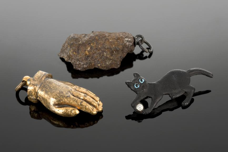 From left to right: A79870, Amulet, King Edward's hand, metal, gilt, supposedly worn by man of a London regiment, from