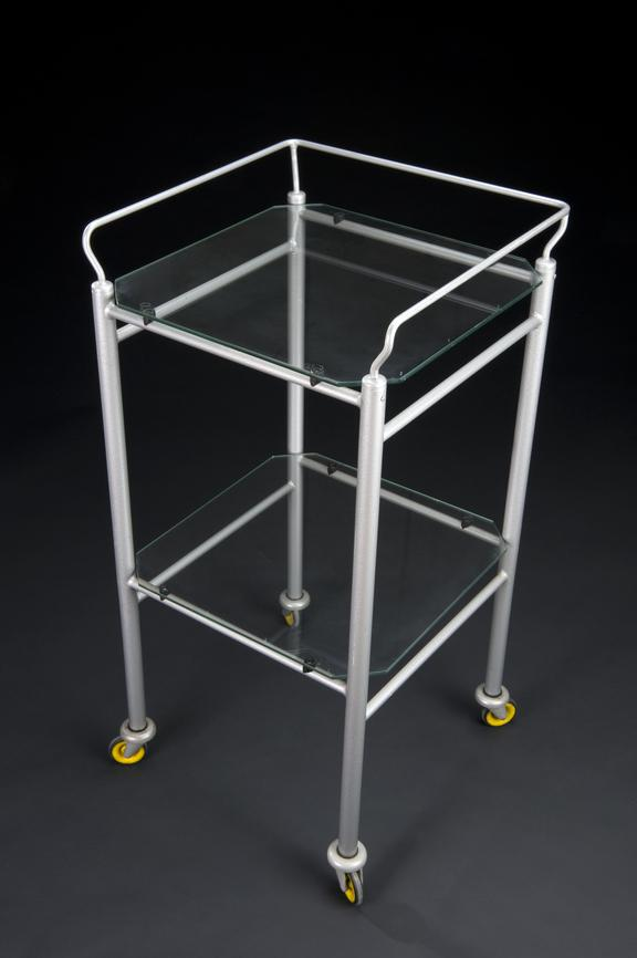 hospital dressing trolleys, square, with metal tubular frames and glass shelves, used in Breath of Life Exhibition,