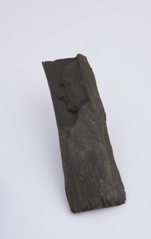 1 Reproduction on piece of ebony, 4 1/8 x 1 1/4''