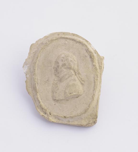 Plaster cast, oval 1 1/4 x 7/8''