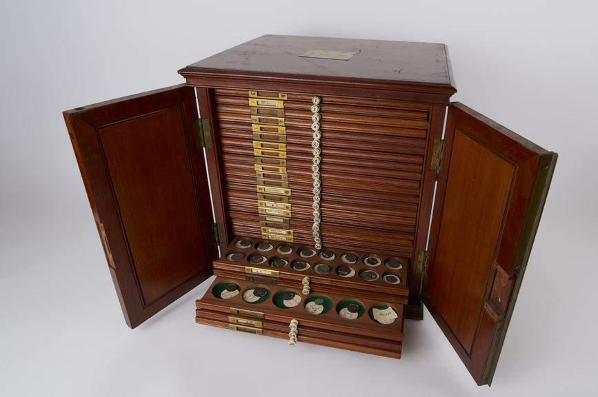 Collection of  564 coins, contained in cabinet A', size 38x36x32cm / 15'x13'x13'. (Printed V&A Inventory Cards taken