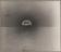 Eight photographs (and one explanatory label) showing the test atomic bomb explosion in New Mexico in July, 1945, being