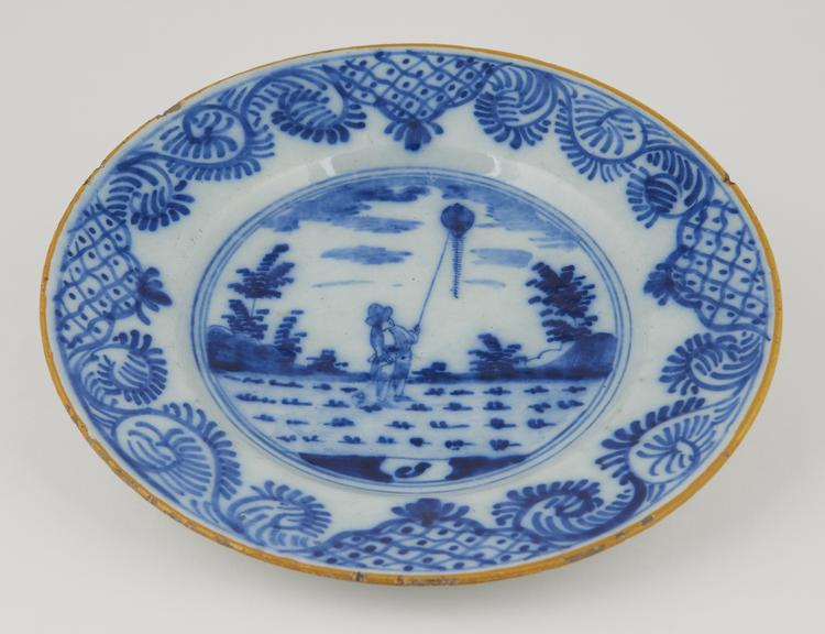 One soup-plate in white and blue.   9 1/4.   Man flying kite.'