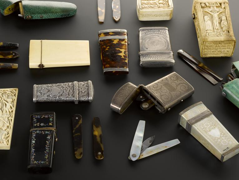 Group shot comprising of various lancets and lancet cases from the Science Museum Group collection.