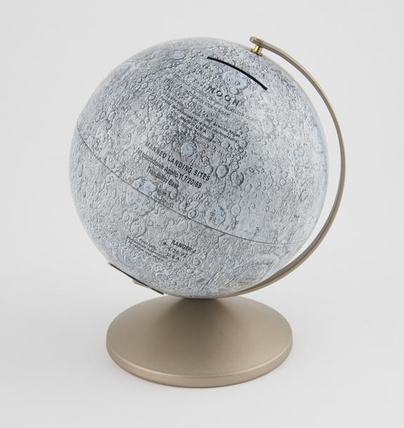 Lunar globe, with booklet The Story of the Moon' by R.I. Johnson'